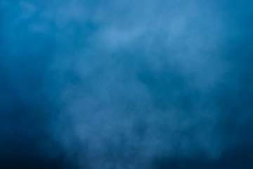 Abstract white water vapor on a blue background. Texture. Design elements.