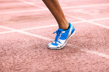 Closeup of a woman's leg running on a track.