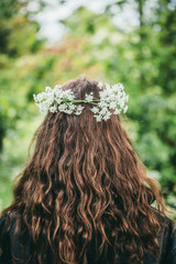 flower headband worn in beautiful long brown hair