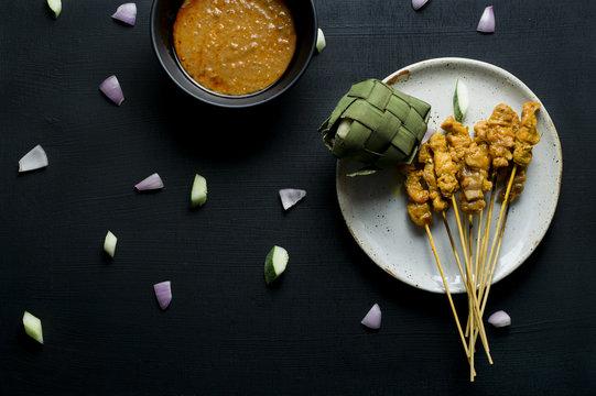 Chicken satay with ketupat and peanut sauce