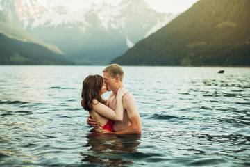 Young couple swimming in lake
