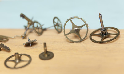Parts of deconstructed watch lying on table