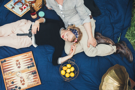 Overhead view of couple enjoying picnic outdoors