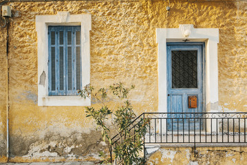 Beautiful authentic greek house in blue and yellow