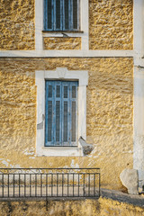 Detail of a blue windows in old building in Greece