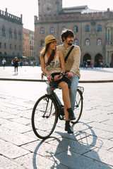 Lovely couple commuting by bike