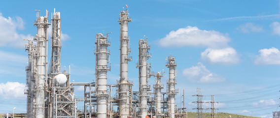 Oil refinery, oil factory, petrochemical plant in Pasadena, Texas, USA under cloud blue sky. Panorama style.