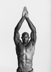 Black and white portrait of strong african male posing in studio