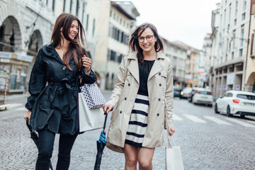 Female Young Friends Doing Shopping in the City