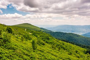 green grassy slope of Runa mountain ridge. Gorgeous landscape of Ukrainian Carpathians on cloudy summer day.