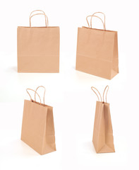 Four brown paper bags on a white background
