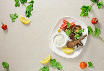 Lamb chops served with tzatziki sauce
