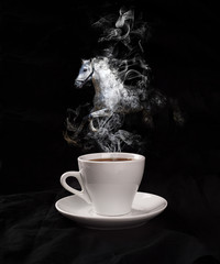 Cup of coffee with a horse from a pair on a black background