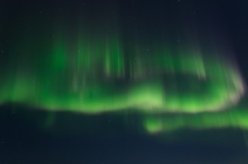 Stars, clouds and aurora borealis.