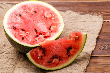 Photo of cut watermelon on cloth