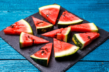 Photo of slices of watermelon on cutting board