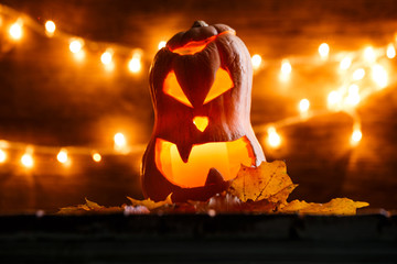 Photo of halloween pumpkin cut in shape of face