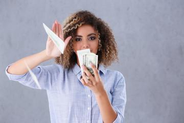 Beautiful black woman portrait. Scattering money notes