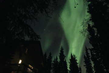 Northern Lights over a Cabin