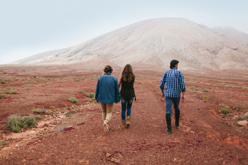 Group of Friends Walking Through a Desert Together