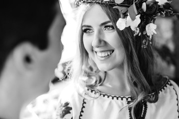 Cheerful bride with beautiful smile looks happy in love at her h