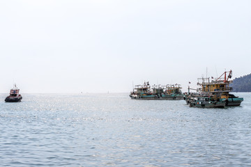Row of Malaysian fishing boats at the bay close to Kota Kinabalu, Borneo, Malaysia