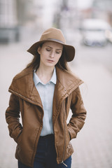 young woman with hat walking