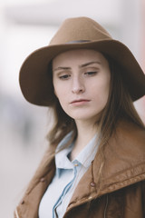 portrait of young woman with hat .