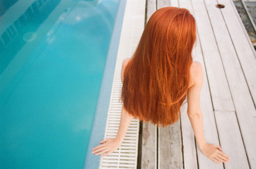 Back view of the woman with extremely long ginger hair