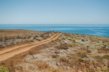 Dirt road  leading to ocean