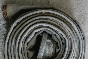 Wrapped old fire hoses on the floor