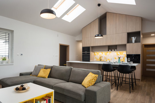 Living-room connected with kitchen in background, contemporary house interior
