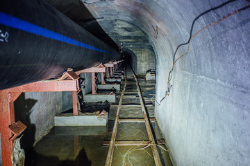 Construction of sewer pipeline from plastic pipes in sewer tunnel with narrow-gauge railway