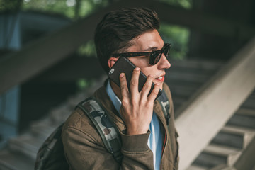 Man talking on phone outside.