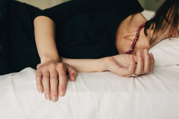 woman lying on a bed