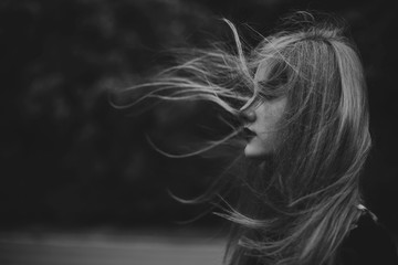 Young woman with hair blowing in the wind
