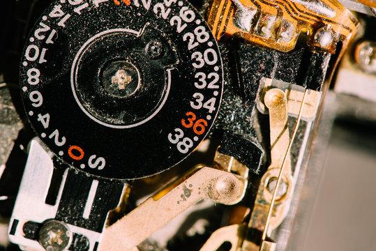 Extreme closeup of an old film camera taken apart.