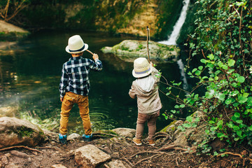 Young boys fishing in a river.