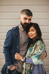 Fashionable hipster interracial couple