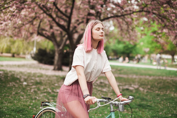 Pink haired girl on the bike