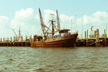 Rusted fishing boat. Old crab lobster shrimp boat. Rusty steel boat docked. Fishing marine boat at dock