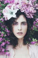 Woman portrait with pink flowers