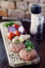 Raw burger patties