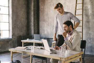 Businessmen working together in a contemporary office