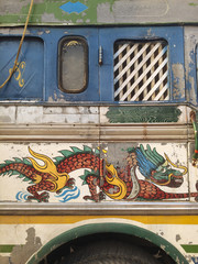 A truck with a dragon painted on its side.