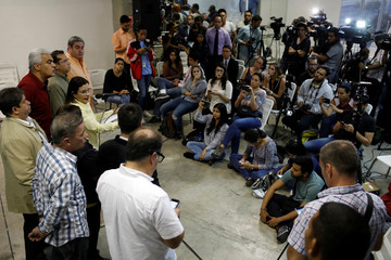 MUD representative Hernandez talks to the media during a news conference in Caracas