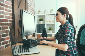 sweet female photographer looking at computer