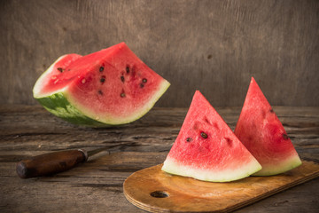 Watermelon on the wooden background. Organic watermelon