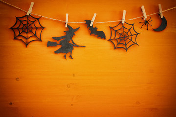 Halloween holiday concept top view scene over wooden background