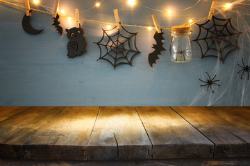 Halloween holiday background with empty rustic table. Ready for product display montage